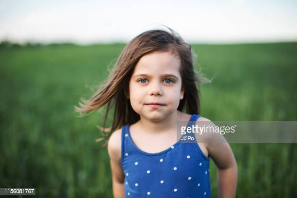 little girl portrait at the field - children only stock pictures, royalty-free photos & images