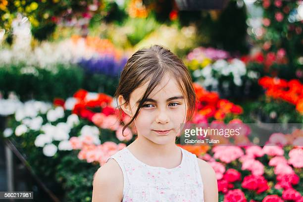 Little girl portrait surrounded by flower