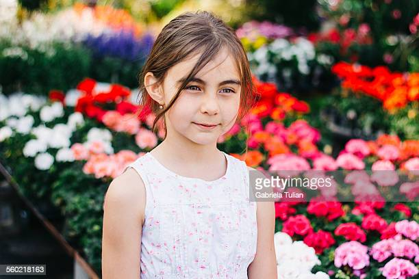 Little girl portrait surrounded by flowers