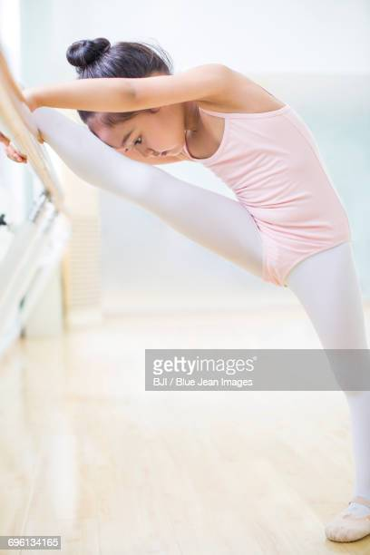 little girl practicing ballet - girl with legs spread stock photos and pictures