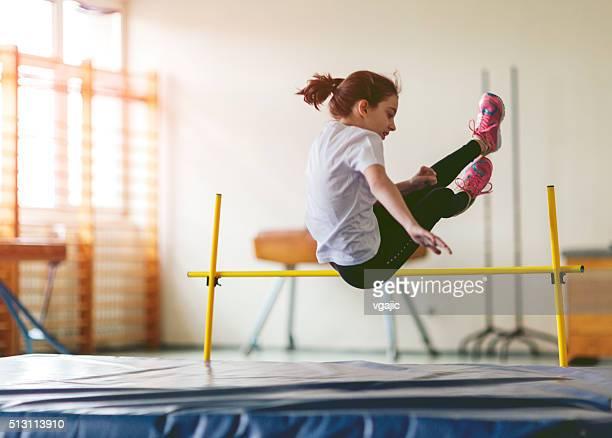 Little Girl Practicing High Jump.