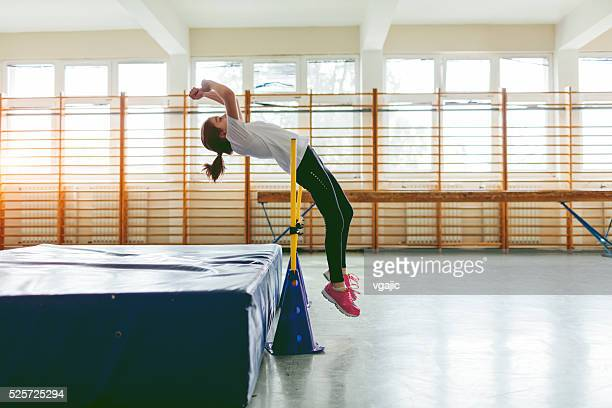 little girl practicing high jump. - high jump stock pictures, royalty-free photos & images