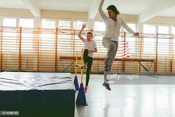 little girl practicing high jump with her instructor. - women's field event stock pictures, royalty-free photos & images