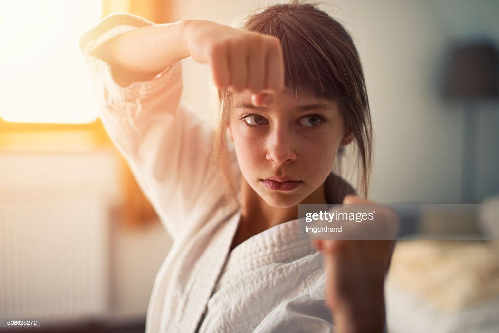 Little girl practicing karate : Stock Photo