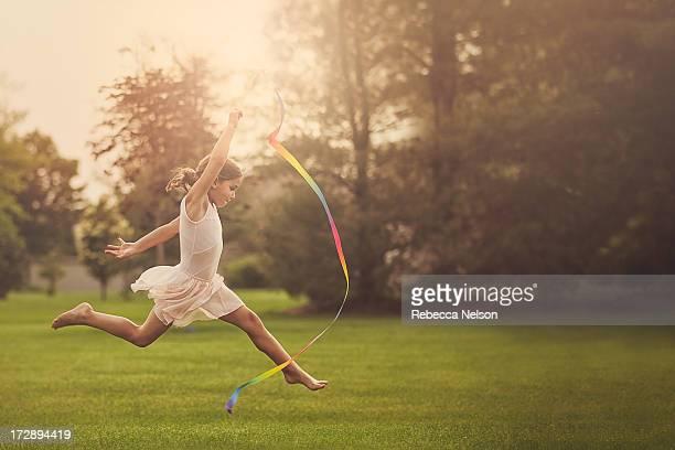 Little girl practicing ribbon gymnastics