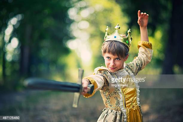 little girl practicing swordplay - princess that doesnt need saving - fairytale stock pictures, royalty-free photos & images