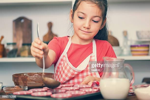 Little Girl Preparing Chocolate Cookies at Home