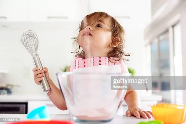 Little girl preparing jello