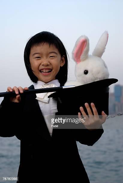 Little Girl Pretending to be a Magician