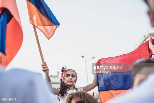 A little girl protester holding a Armenian flags during a demonstration to mark the 103rd anniversary of the Armenian Genocide by Turkey Protesters...