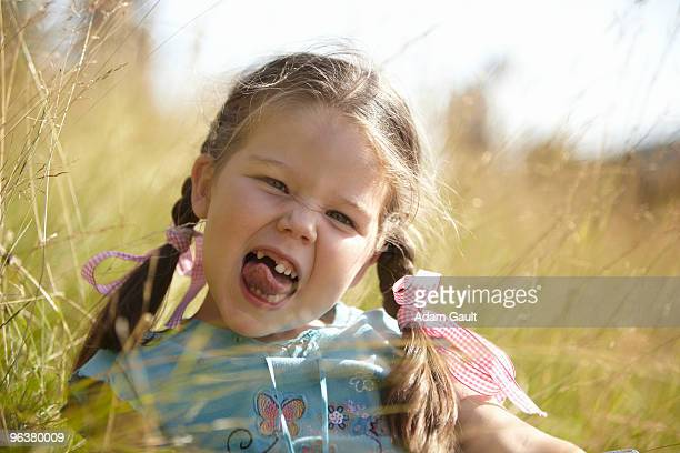 Little Girl Pulling a Cheeky Face