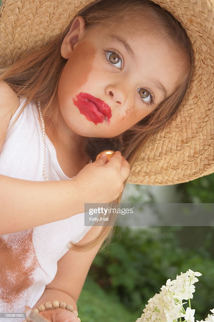 Makeup Ideas makeup for little girls pics : Little Girl Putting On Makeup Stock Photo | Getty Images