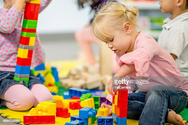 Little Girl Putting Together Legos