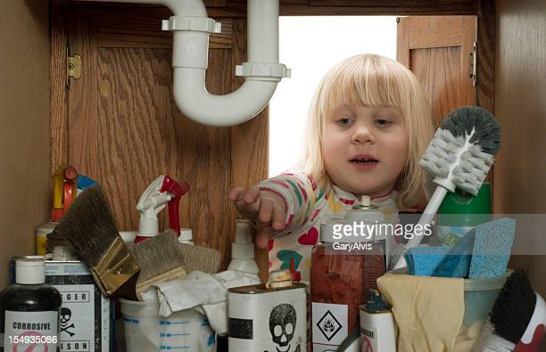 child safety series-#2 little girl reaching under sink - clorox bleach stock pictures, royalty-free photos & images