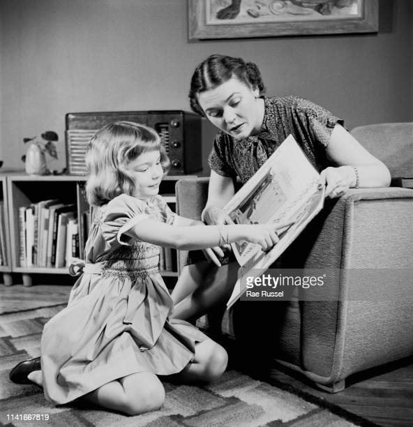 A little girl reading a 'Cinderella' book to get inspiration for her 'dream' dress which will be handmade and tailored by a dressmaker at a McCall...