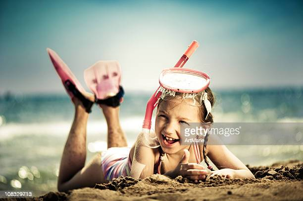 little girl ready for snorkeling - little girl laying on the beach stock photos and pictures