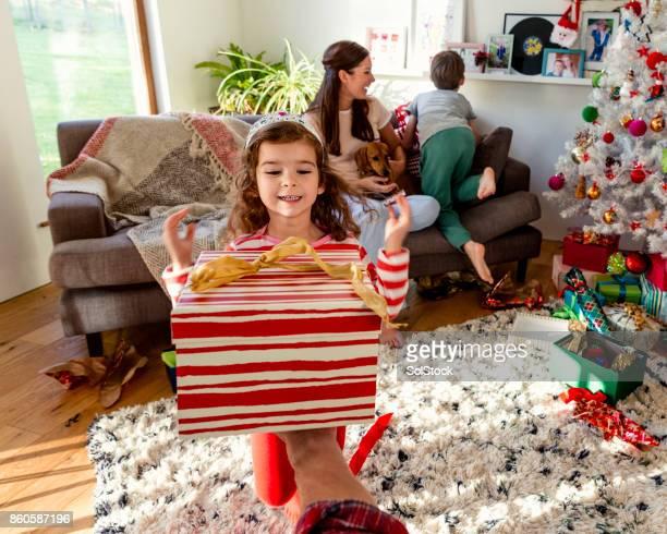 Little Girl Receiving a Christmas Presents