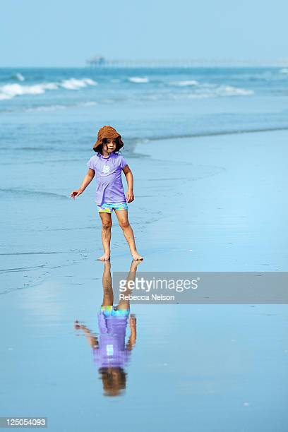 little girl reflection in sea - rebecca nelson stock pictures, royalty-free photos & images
