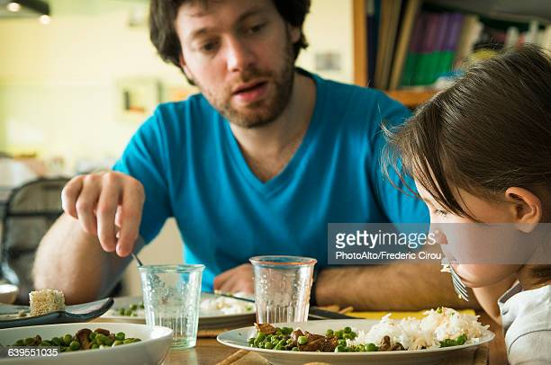 little girl refusing to eat her dinner - stubborn stock pictures, royalty-free photos & images