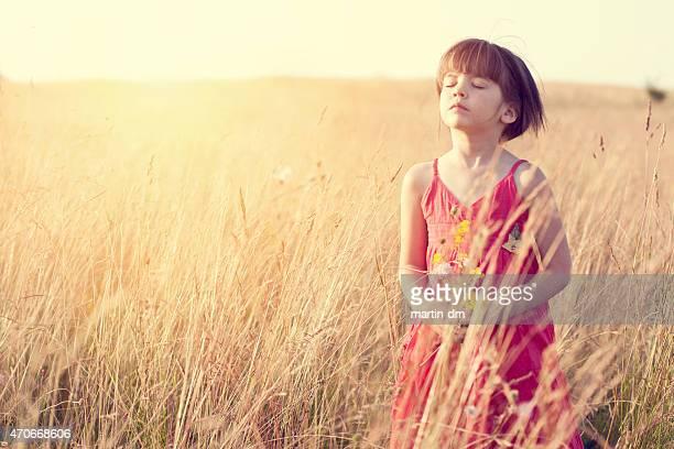 Little girl relaxing among nature