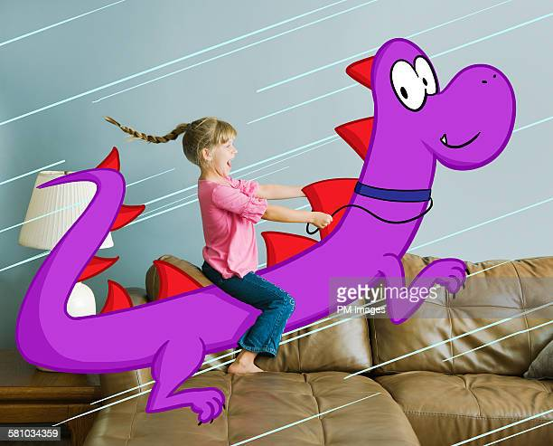 Little girl riding illustrated dragon