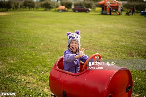 Little Girl Riding In a Barrel Car