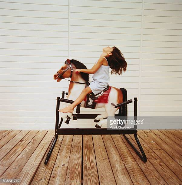 Little Girl Riding Rocking Horse