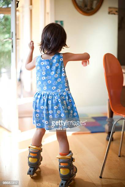 little girl roller skating indoors