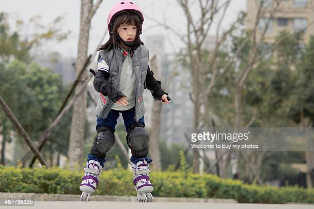 little girl roller skating - padding stock pictures, royalty-free photos & images