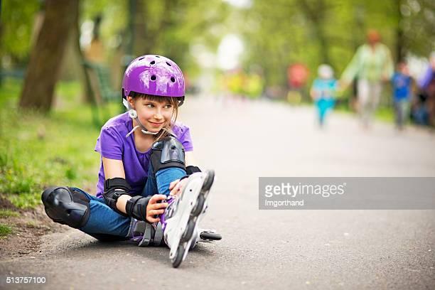 Little girl rollerskating in park