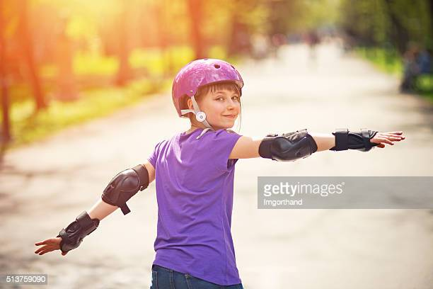little girl rollerskating in park - inline skating stock pictures, royalty-free photos & images