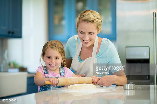 Little Girl Rolling Out Cookie Dough