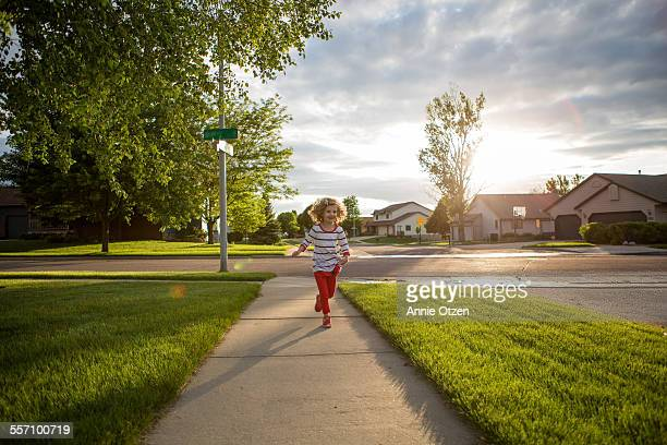 little girl running - residential district stock pictures, royalty-free photos & images