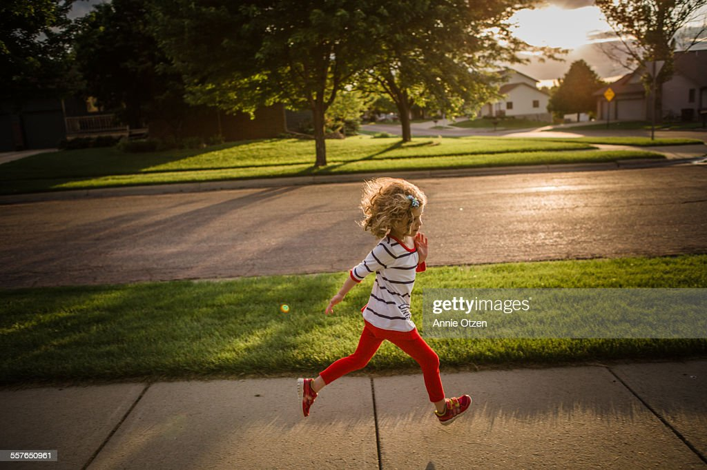 Little girl running : Stock Photo