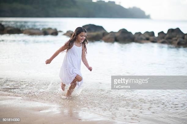 Little Girl Running Through the Ocean