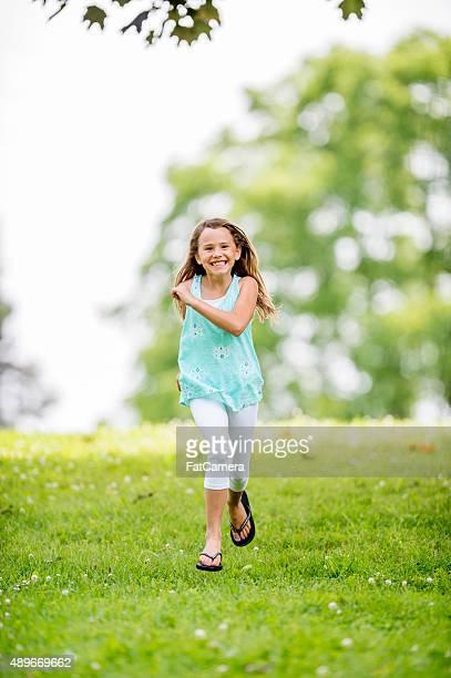 Little Girl Running Through the Park