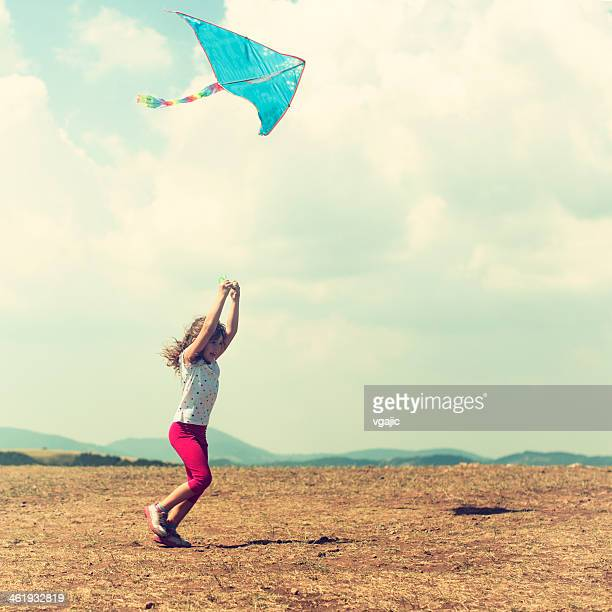 Little Girl Running With Kite Outdoors.