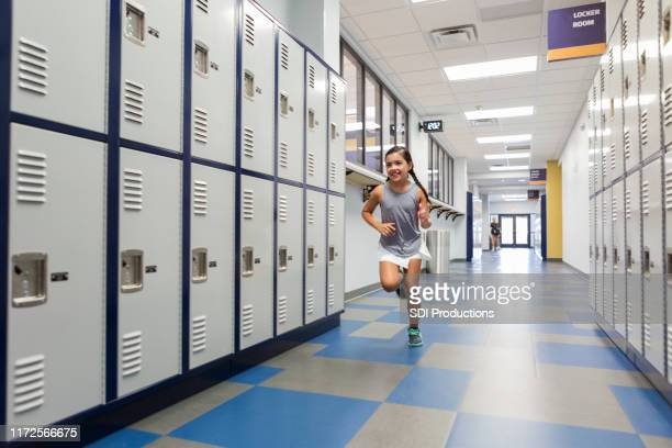 little girl runs in locker room - school girl shoes stock pictures, royalty-free photos & images