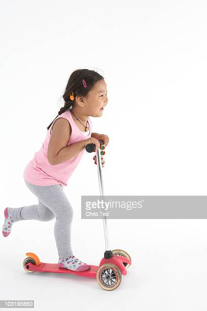 Little girl rushing around in her scooter