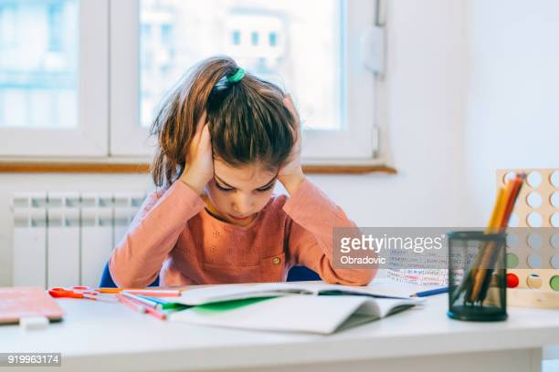 little girl scared from her homework - struggle stock pictures, royalty-free photos & images