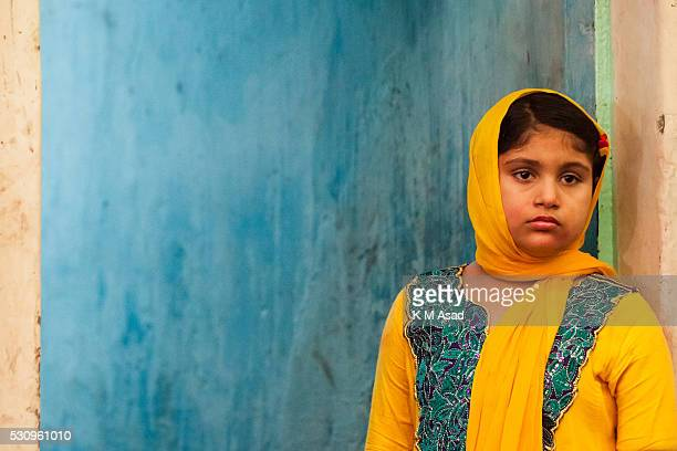 A little girl seen offering pooja to Bipadtarini Devi in Dhaka Bangladesh July 25 2015 During the ritual of people from Hindu community take long day...