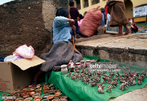 A little girl selling small items in the San Cristobal de Las Casas market Chiapas Mexico