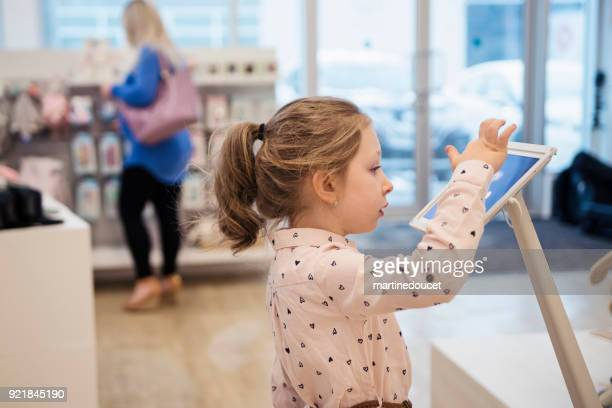 little girl shopping in children store. - digital native stock pictures, royalty-free photos & images
