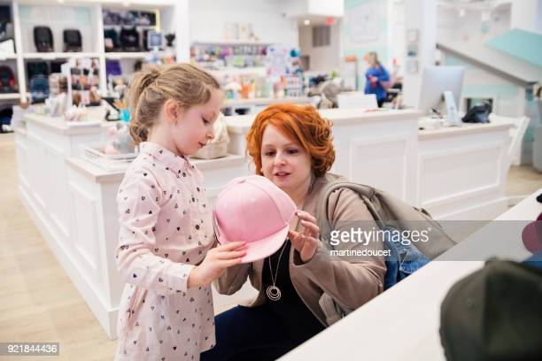 "little girl shopping with mother in children store. - ""martine doucet"" or martinedoucet stock pictures, royalty-free photos & images"