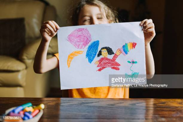 little girl showing her drawing - painted image stock pictures, royalty-free photos & images