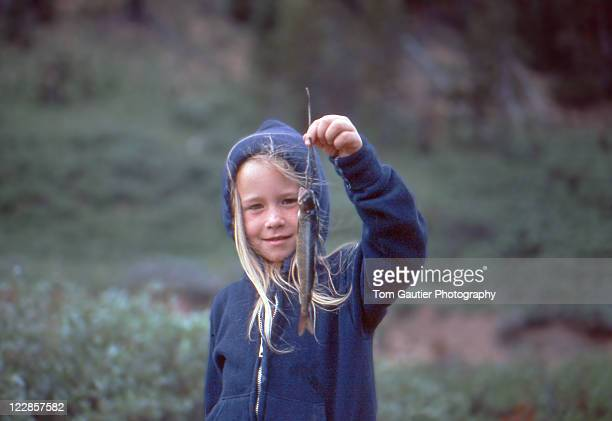 Little girl showing off trout