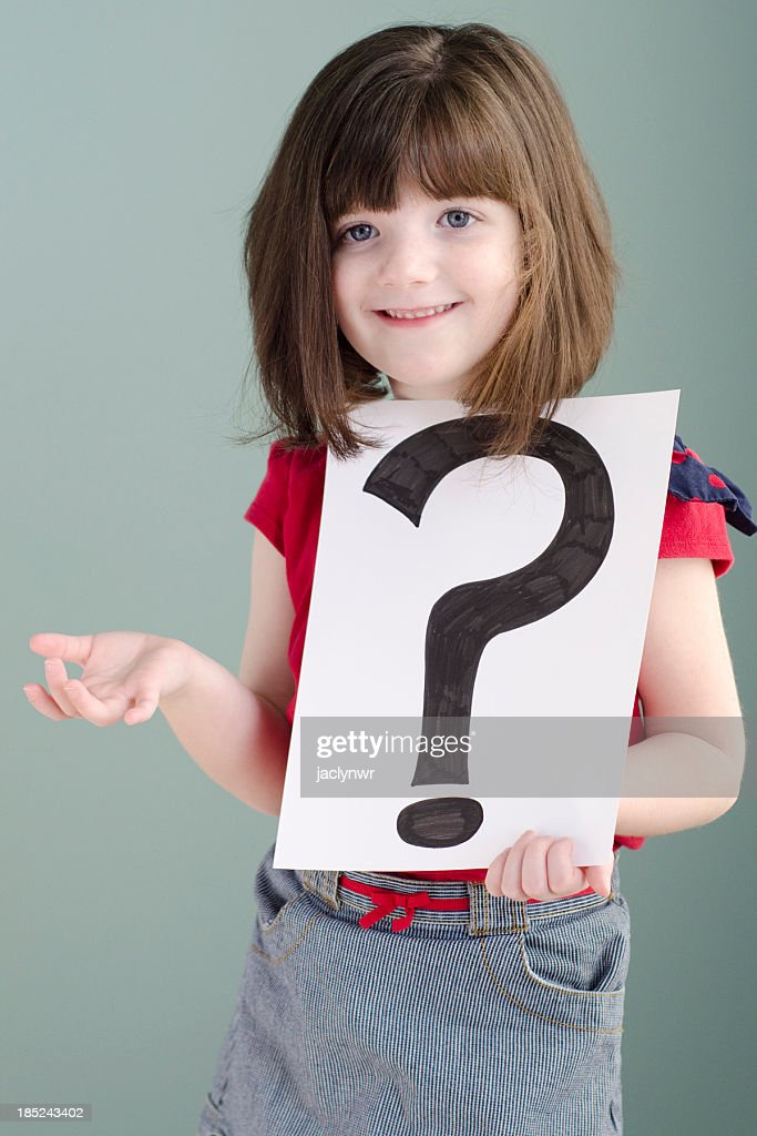 little girl shrugs while holding a question mark stock photo getty