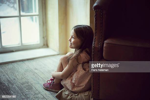 little girl sitting by the window - little russian girls stock photos and pictures
