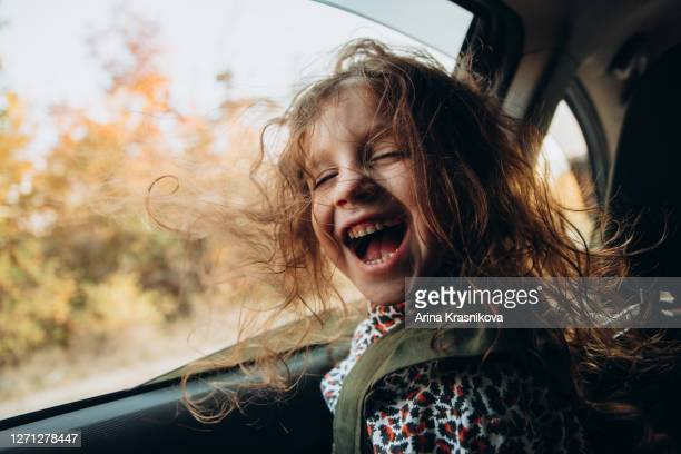 little girl sitting in the car - seat stock pictures, royalty-free photos & images