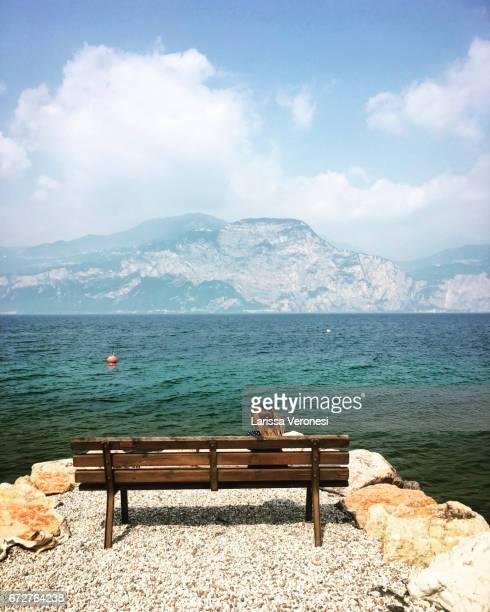 Little girl sitting on bench, Lake Garda, Brenzone Sul Garda